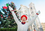 Woman traveler with Italian flag enjoying Christmas in Florence