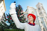 Traveler woman taking selfie in Christmas decorated Florence