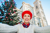 Woman tourist taking selfie in сhristmas decorated Florence