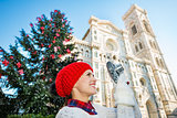 Young woman traveler making photos of Christmas in Florence