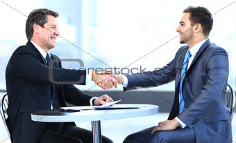 Business colleagues sitting at a table during