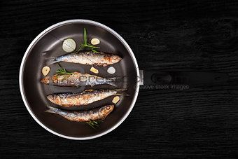 Grilled anchovy fish on pan.
