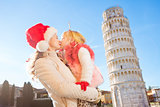 Mother and daughter spending Christmas time in Pisa, Italy