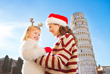 Happy mother in Christmas hat and daughter. Christmas in Pisa