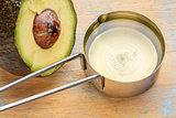 avocado oil in measuring cup