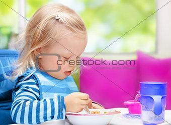 Little baby having breakfast