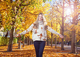 Young woman enjoying the colors of autumn