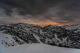 Cloudy night winter mountain landscape