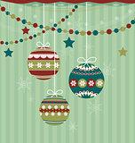 Three Christmas balls on striped background