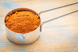 paprika powder on measuring scoop
