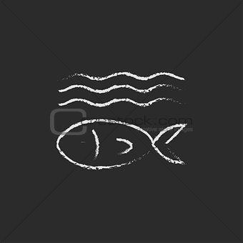 Fish under water icon drawn in chalk.