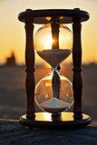 sand timer at sunset