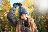 Portrait of smiling young girl in autumn