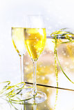 Two glasses of wine and a box on white background
