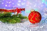 Red Christmas ball, fir branch and with gift box. Christmas deco