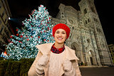 Happy woman standing near Christmas tree in Florence, Italy