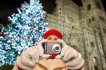 Close up on camera in hands of woman in Christmas Florence