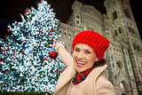 Woman pretend decorating Christmas tree in Florence, Italy
