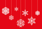 Hanging snowflakes on a red background vector