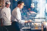 male cooks preparing meal
