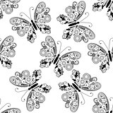 Seamless pattern with black lacy butterflies