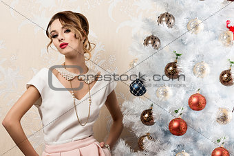 aristocratic woman near xmas tree