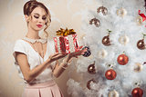 elegant woman with xmas gift