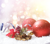 Christmas background of decorations nestled in snow