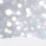 Silver Christmas background with mounds of snow
