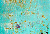 Rusty painted blue metal texture with cracked paint.
