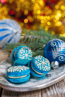 Blue macarons with Christmas decor.