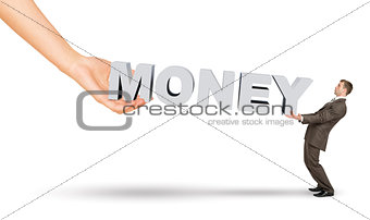 Businessman and hand holding word money