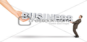 Businessman and hand holding word business