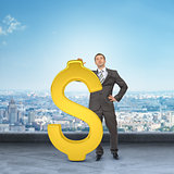 Businessman leaning on big dollar sign