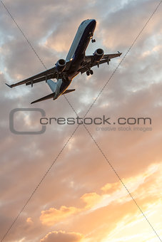 Airplane Flying at Sunset or Sunrise