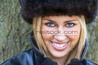 Beautiful Blond Woman With Blue Eyes in Fur Hat
