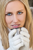 Blond Woman In Gloves Drinking Warm Drink
