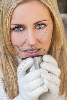 Blond Woman In Gloves Drinking Warm Drink