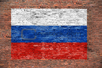 Flag of Russsia painted over brick wall