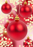 Christmas balls on red sparkling background.