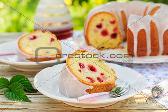 A Slice of Lemon and Caraway Seed Bundt Cake with Raspberries