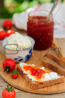 Slices of Brown Bread with Cream Cheese and Tomato and Chili Jam