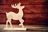 wooden reindeer on a rustic wooden surface