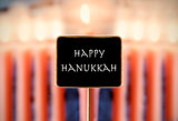 menorah and text happy Hanukkah in a chalkboard