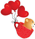 Teddy bear flying in red cup with heart balloons