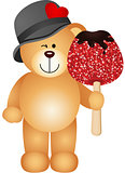Teddy bear holding candied apple