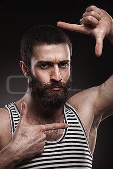 portrait of beardy man in singlet