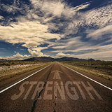 Conceptual Image of Road With the Word Strength