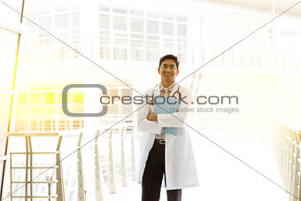 Asian Indian medical doctor holding medical report