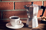 coffee in mug and coffee maker